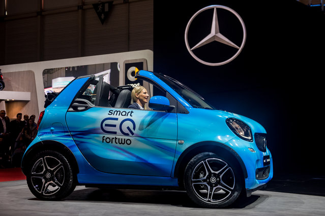 Smart EQ For Two is being presented at the Press Conference at the 88th Geneva International Motor Show on March 6, 2018 in Geneva, Switzerland. Global automakers are converging on the show as many seek to roll out viable, mass-production alternatives to the traditional combustion engine, especially in the form of electric cars. The Geneva auto show is also the premiere venue for luxury sports cars and imaginative prototypes. (Photo by Robert Hradil/Getty Images)