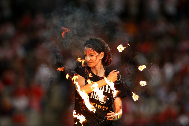 Fire dancers perform ahead of the round one NRL match between the St George Illawarra Dragons and the Brisbane Broncos at UOW Jubilee Oval on March 8, 2018 in Sydney, Australia. (Photo by Mark Kolbe/Getty Images)