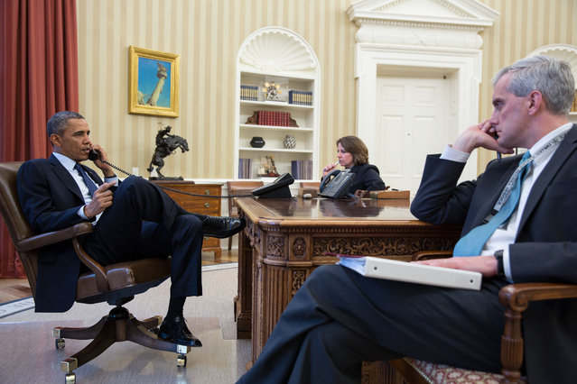 In this handout provided by the White House, U.S. President Barack Obama (L) talks on the phone with FBI Director Robert Mueller to receive an update on the explosions that occurred in Boston, in the Oval Office of the White House, April 15, 2013 in Washinton, DC. Seated with the President are Lisa Monaco, Assistant to the President for Homeland Security and Counterterrorism, and Chief of Staff Denis McDonough. Two people are confirmed dead and at least 23 injured after two explosions went off near the finish line to the marathon. (Photo by Pete Souza/The White House)