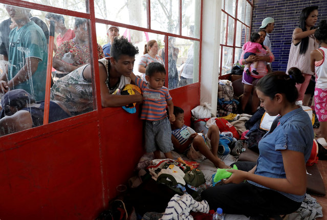 Central American migrants, part of a caravan moving through Mexico toward the U.S. border, gather at a makeshift centre of Mexico's National Institute of Migration to register, in Matias Romero, Mexico April 4, 2018. (Photo by Henry Romero/Reuters)