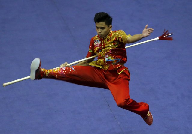 Singapore's Adalia Jesse Colin competes in the men's qiangshu final during the 13th World Wushu Championship 2015 at Istora Senayan stadium in Jakarta, November 17, 2015. (Photo by Reuters/Beawiharta)
