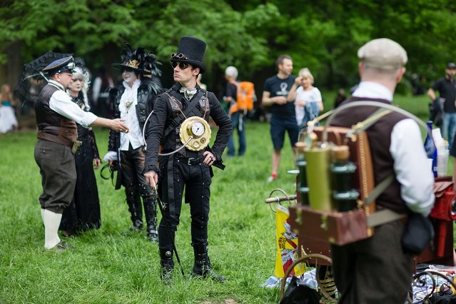 A man dressed in a steam-punk costume attends the traditional park picnic on the first day of the annual Wave-Gotik Treffen, or Wave and Goth Festival, on May 17, 2013 in Leipzig, Germany. The four-day festival, in which elaborate fashion is a must, brings together over 20,000 Wave, Goth and steam punk enthusiasts from all over the world for concerts, readings, films, a Middle Ages market and workshops. (Photo by Marco Prosch)