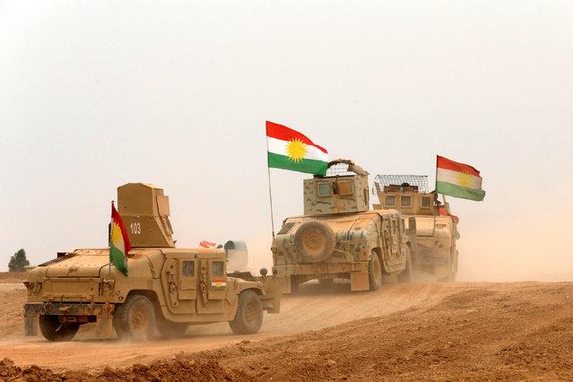 Kurdish Peshmerga military vehicles drive during a battle with Islamic State militants at Jarbuah village near Bashiqa near Mosul, Iraq, October 28, 2016. (Photo by Ahmed Jadallah/Reuters)