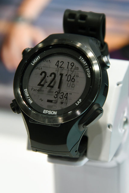 Epson's Runsense SF-810 sports smartwatch with built-in optical heart rate sensor technology is displayed at the 2015 International CES at the Sands Expo and Convention Center on January 6, 2015 in Las Vegas, Nevada. The USD 349 device has a GPS tracker and a stride sensor useful for runners and cyclists. (Photo by Ethan Miller/Getty Images)