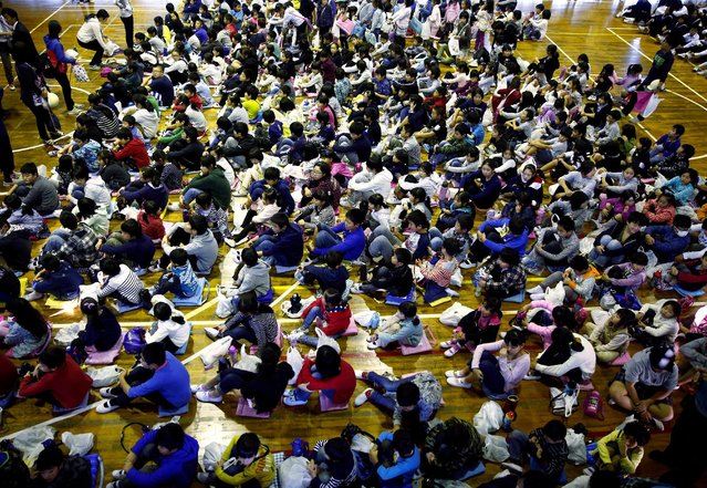 School children gather in an evacuation shelter on a hill during a tsunami simulation drill ahead of World Tsunami Awareness Day at Futaba elementary school in Choshi, Chiba Prefecture, Japan, November 4, 2016. (Photo by Kim Kyung-Hoon/Reuters)