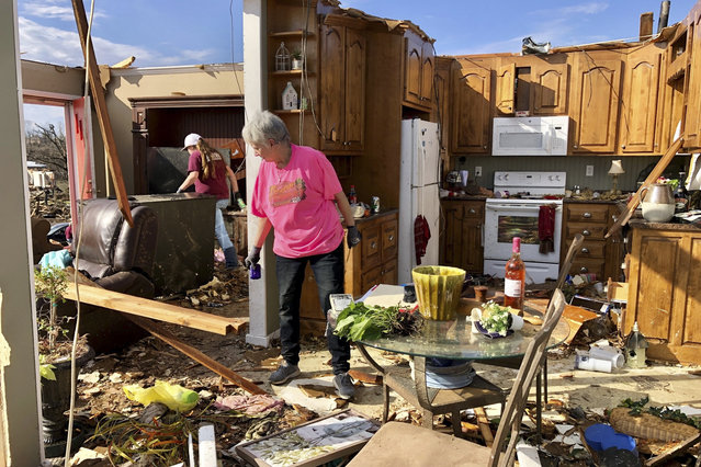 Patti Herring sobs as she sorts through the remains of her home in Fultondale, Ala., on Tuesday, January 26, 2021, after it was destroyed by a tornado. (Photo by Jay Reeves/AP Photo)