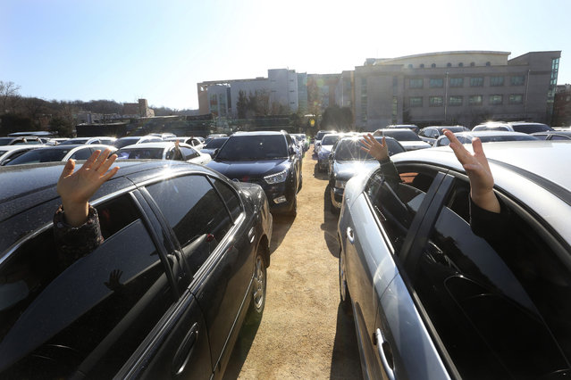 Christians inside their cars pray during a drive-in worship service amid measures to prevent the spread of the coronavirus at Songgok high school in Seoul, South Korea, Sunday, January 17, 2021. (Photo by Ahn Young-joon/AP Photo)