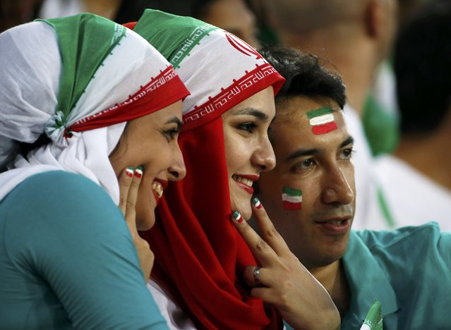 Iran fans pose for pictures before the start of their Asian Cup Group C soccer match against UAE at the Brisbane Stadium in Brisbane January 19, 2015. (Photo by Edgar Su/Reuters)