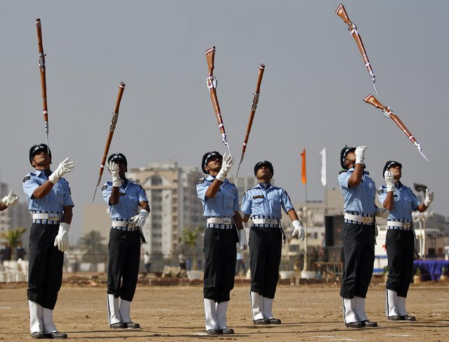 Air Warriors from the Indian Air Force (IAF) perform during an awareness drive in the western Indian city of Ahmedabad, January 17, 2015. (Photo by Amit Dave/Reuters)