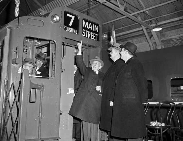 Vincent R. Impellitteri, right, acting mayor of New York City, and Brooklyn Borough President John Cashmore (second from right), inspect the first completed subway car of an order for 750, at the American Car and Foundry Co., Berwick, Penn., February 20, 1948. C.J. Hardy, Sr., company chairman, points out a feature of the new cars. Men inside subway cab are unidentified. (Photo by AP Photo/HG)