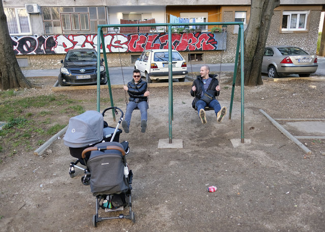 People play on swings at a playground in Mostar, Bosnia, Sunday, December 20, 2020. Divided between Muslim Bosniaks and Catholic Croats, who fought fiercely for control over the city during the 1990s conflict, Mostar has not held a local poll since 2008, when Bosnia's constitutional court declared its election rules to be discriminatory and ordered that they be changed. (Photo by Kemal Softic/AP Photo)