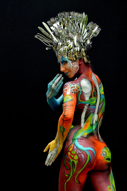 A participant poses with her body paintings designed by bodypainting artist Tera Bakker during the 16th World Bodypainting Festival on July 5, 2013 in Poertschach am Woerthersee, Austria. (Photo by Didier Messens/Getty Images)