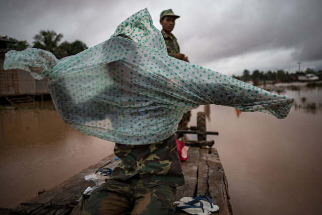 Soldiers make their way to affected villages after flash floods engulfed these several villages, on July 26, 2018 in Attepeu, southeastern Laos. (Photo by Jes Aznar/Getty Images)