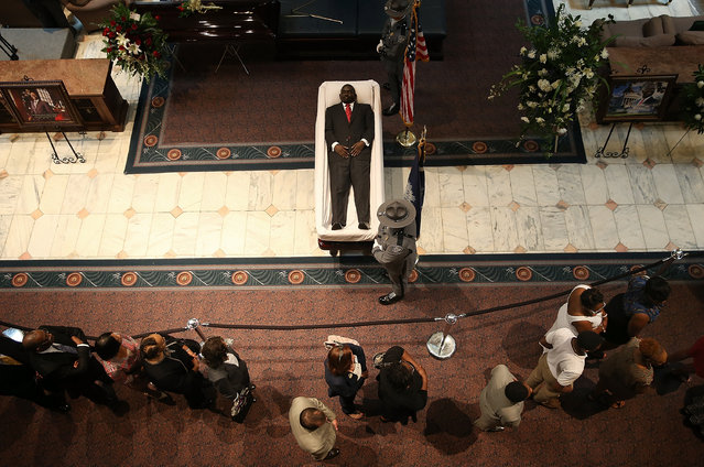 Visitors pay their respects during an open viewing for Rev. Clementa Pinckney at the South Carolina State House June 24, 2015 in Columbia, South Carolina. Pinckney was one of nine people killed during a Bible study inside Emanuel AME church in Charleston. U.S. President Barack Obama and Vice President Joe Biden are expected to attend the funeral which is set for Friday June 26 at the TD Arena. (Photo by Win McNamee/Getty Images)