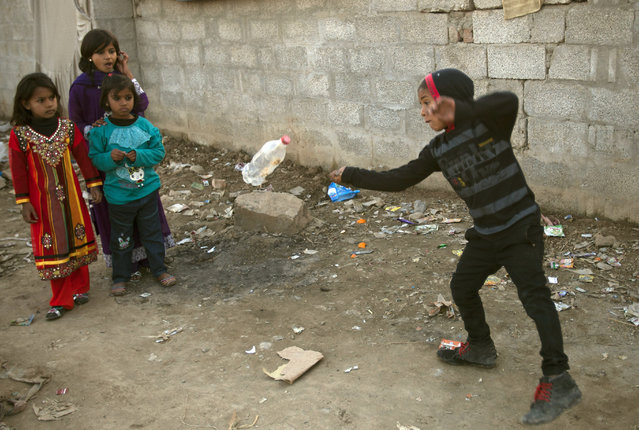 A Pakistani boy demonstrates his skill in an Islamabad's slum, Wednesday, February 11, 2015 in Pakistan. (Photo by B. K. Bangash/AP Photo)