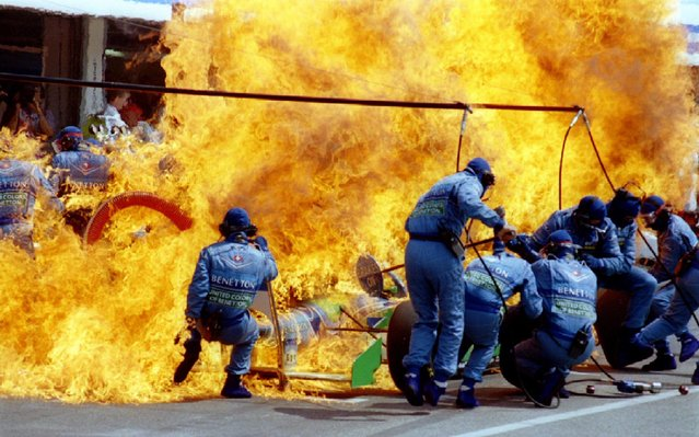 Petrol sprays on the Formula One racing car of Netherland's Jas Verstappen seconds before the car and the crew of Benetton Ford caught on fire during refueling at the German F-1 Grand Prix in Hockenheim in this July 31, 1994 file photo. (Photo by Joachim Herrmann/Reuters)