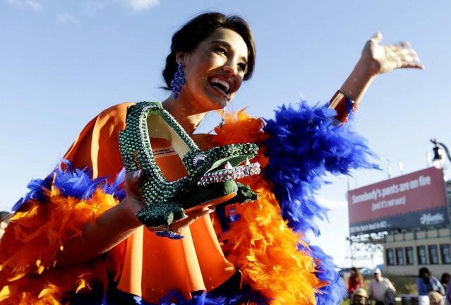 Miss Florida Myrrhanda Jones shows her shoe during the Miss America Shoe Parade. (Photo by Julio Cortez/Associated Press)