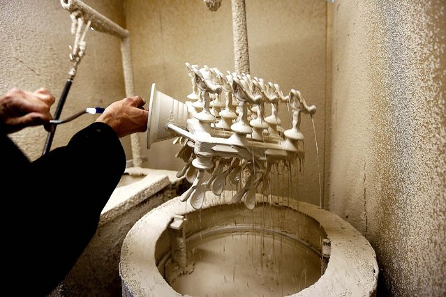 """Worker Frank Tildesley works on a form of the """"Spirit of Ecstasy"""". (Photo by Stefan Wermuth/Reuters)"""