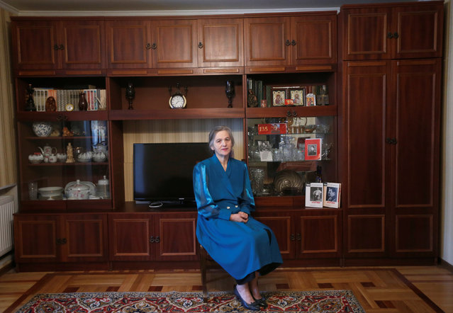 """Retired accountant Olga Danelia, 62, poses for a portrait at her home in Rustavi, Georgia, November 28, 2016. Danelia is a Communist Party leader in her town. """"Nowadays there are two types of people: those who love Stalin and others who hate him. We have to tell them the truth"""", Danelia said. """"There were tough times, a lot of enemies around. Despite this, Stalin managed to build the country. I think he deserves to be remembered lovingly. We have to teach this to our youth, in schools, in the media"""". (Photo by David Mdzinarishvili/Reuters)"""