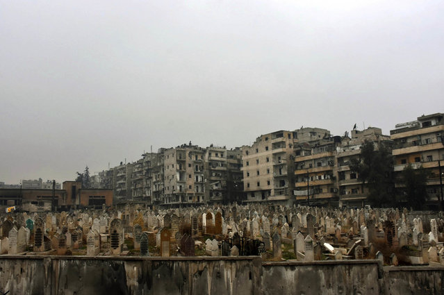 This photo released by the Syrian official news agency SANA, shows a graveyard in east Aleppo, Syria, Tuesday, December 13, 2016. Syrian rebels said Tuesday that they reached a cease-fire deal with Moscow to evacuate civilians and fighters from eastern Aleppo, after the U.N. and opposition activists reported possible mass killings by government forces closing in on the rebels' last enclave. (Photo by SANA via AP Photo)