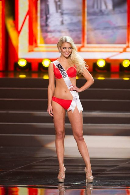 A handout picture provided by the Miss Universe Organization shows Lotta Hintsa, Miss Finland 2013, competing in the swimsuit competition during the Preliminary Competition at the Crocus City Hall, in Moscow, Russia, 05 November 2013. (Photo by Darren Decker/EPA)