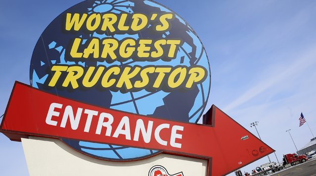 "The road entrance to the ""World's Largest Truckstop"" in Walcott, Iowa, March 6, 2015. (Photo by Jim Young/Reuters)"