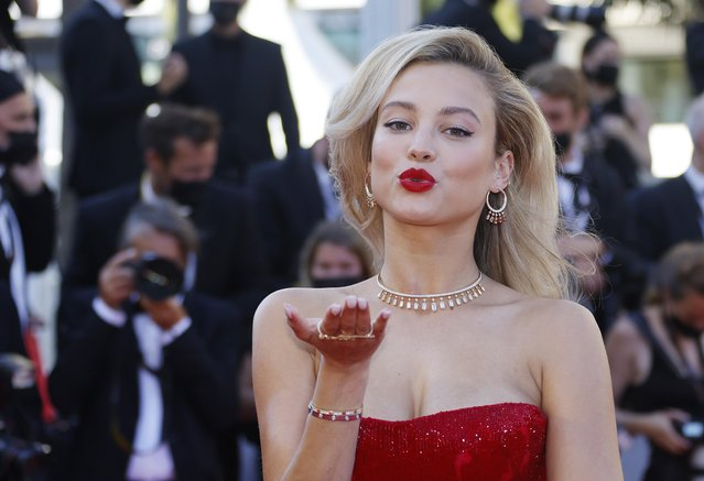 """Belgian model Rose Bertram arrives for the screening of the film """"A Felesegem Tortenete"""" (The Story Of My Wife) at the 74th edition of the Cannes Film Festival in Cannes, southern France, on July 14, 2021. (Photo by Eric Gaillard/Reuters)"""