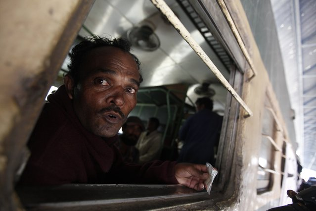 A fisherman from India looks out from a train window, after his release with others from a prison, at Karachi's Cantonment railway station, February 15, 2015. (Photo by Akhtar Soomro/Reuters)