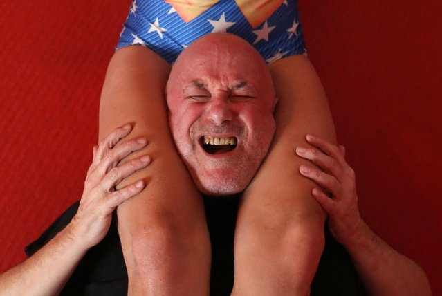 "Professional wrester ""Pippa The Ripper"" holds client Steve ""Monkey Boy"" in a head scissors hold during their BDSM wrestling session at The Submission Room session wrestling and BDSM gym in Seven Sisters, on December 12, 2016 in London, England. (Photo by Susannah Ireland/Barcroft Images)"