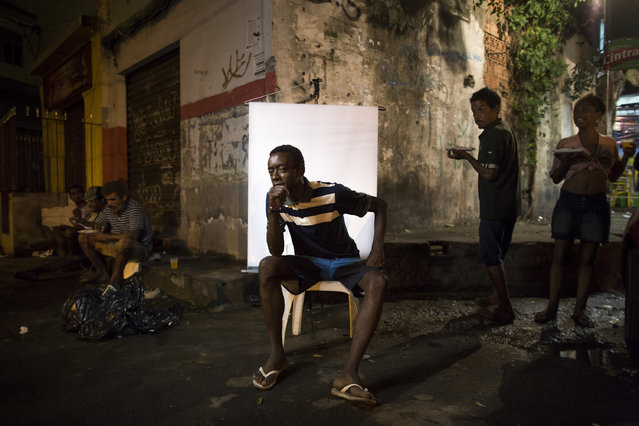 "In this March 14, 2015 photo, Henrique Felix Santos, 41, poses for a portrait in an open-air crack cocaine market, known as a ""cracolandia"" or crackland where users can buy crack, and smoke it in plain sight, day or night, in Rio de Janeiro, Brazil. Henrique, who wanted to be sure his name was spelled correctly, says he has been in this life for quite some time. When asked about his thoughts, he replied: ""The expression of each human being is consistent with reality..."". (Photo by Felipe Dana/AP Photo)"