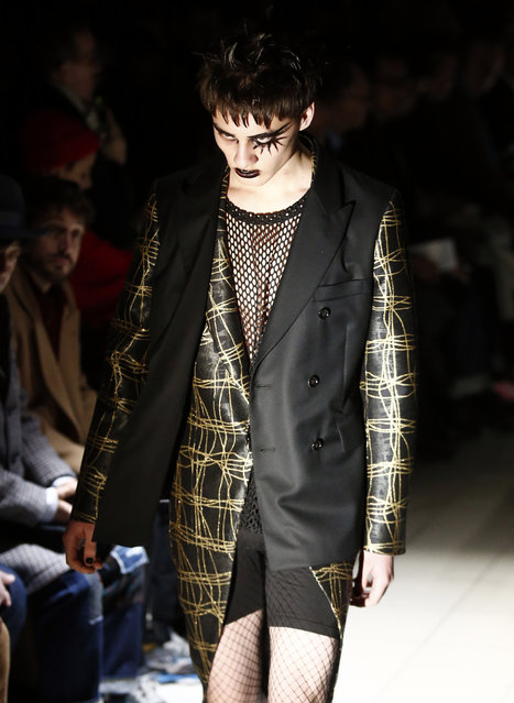 A model wears a creation for the Comme des Garcons men's Fall/Winter 2019/20 fashion collection presented in Paris, Friday January 18, 2019. (Photo by Michel Euler/AP Photo)
