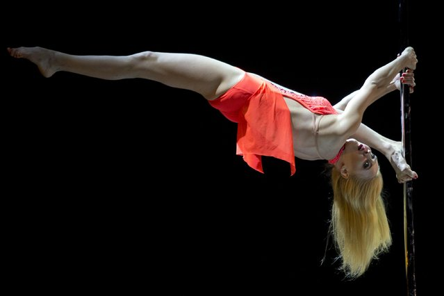 Ukraine's Hanna Antonova competes during the 2015 World Pole Dance Championships held in Beijing, Sunday, April 12, 2015. (Photo by Ng Han Guan/AP Photo)