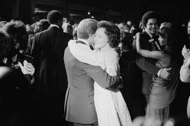 Jimmy and Rosalynn Carter dance at the inaugural ball in Washington, D.C., U.S. January 1977. Rosalynn Carter's gold-trimmed dress was the same she wore to her husband's gubernatorial inauguration six years earlier, designed by Mary Matisse. (Photo by Marion S. Trikosko/Reuters/White House Photo/Library of Congress)