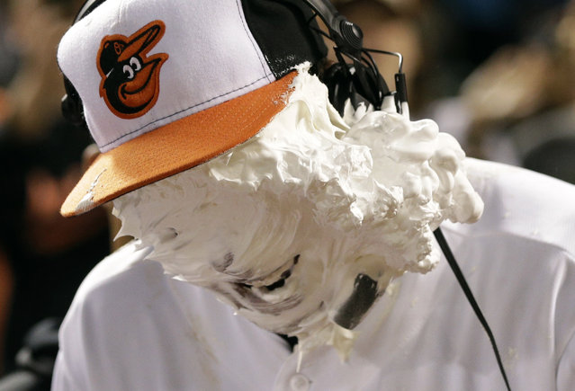 Baltimore Orioles' Jonathan Schoop reacts after teammate Adam Jones covered his face with shaving cream after a baseball game against the Toronto Blue Jays, Wednesday, September 25, 2013, in Baltimore. (Photo by Patrick Semansky/AP Photo)