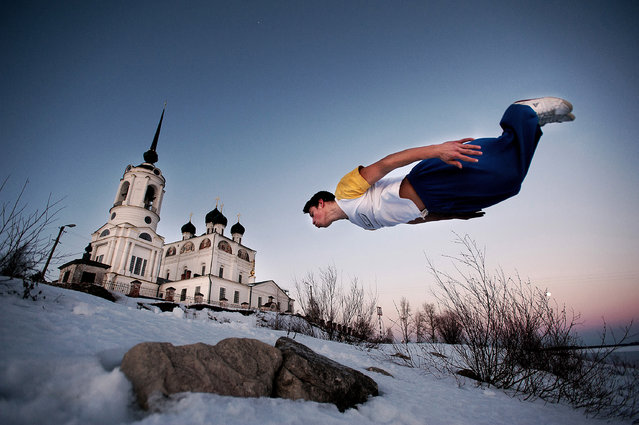Anton Unitsyn, Russia. Shortlist, Professional , Daily Life. Parkour jumpers on their daily training. On the background – one of the main Solvychegodsk sights – Blagoveshchensky Cathedral. This church is among 3 churches, that survived soviet times. At the begining of 20th century there were 13 churches in Solvichegodsk. After breakdown of the communism, Solvichegodsk as many small towns in russia is stuck in it's past. Despite everything, people in Solvichegodsk still belive in their positive future, and wait for wind of change. (Photo by Anton Unitsyn/Sony World Photography Awards)