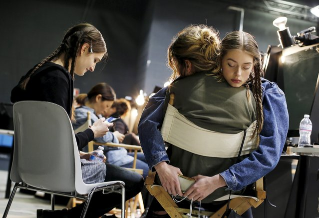 A model rests with a friend backstage of the Aquilano Rimondi Autumn/Winter 2016 woman collection during Milan Fashion Week, Italy, February 27, 2016. (Photo by Alessandro Garofalo/Reuters)