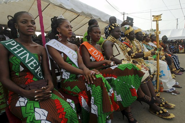 Miss Popo Carnival Yobo Zena Marie Lorraine (2nd L) sits with other candidates during a parade at the Popo (Mask) Carnival of Bonoua, in the east of Abidjan, April 18, 2015. (Photo by Luc Gnago/Reuters)