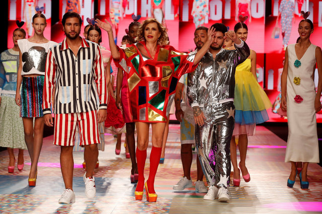 Spanish designer Agatha Ruiz de la Prada (C) greets the public as she joins her models on the catwalk after a fashion show on the opening day of the Mercedes-Benz Fashion Week Madrid, in Madrid, Spain, 16 September 2021. The Mercedes-Benz Fashion Week Madrid (MBFWM2021) runs from 16 to 19 September 2021. (Photo by Juan Carlos Hidalgo/EPA/EFE)