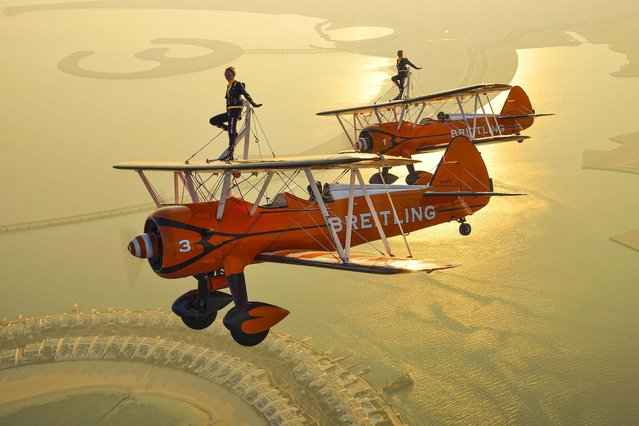 The Breitling Wingwalkers fly over Durrat Al Bahrain on the South coast of Bahrain ahead of the Bahrain International Airshow 2014 which opens, on January 14, 2014. (Photo by Katsuhiko Tokunaga/Breitling)