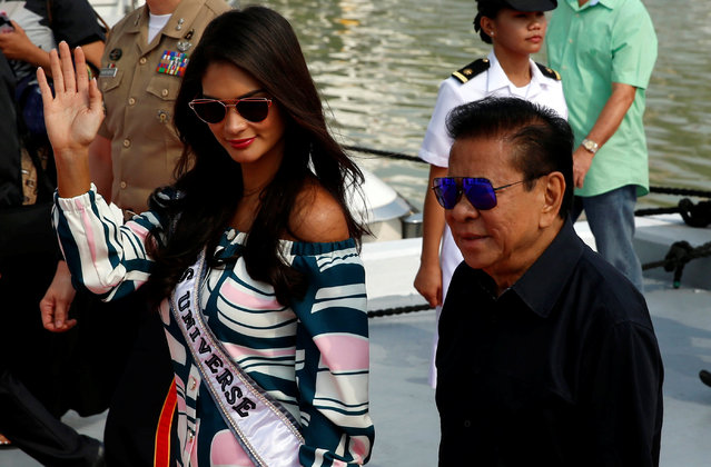 """Filipino tycoon Luis """"Chavit"""" Singson escorts Miss Universe Pia Wurtzbach at the Philippine Navy in Manila, Philippines January 19, 2017. Luis Singson, a larger-than-life Filipino tycoon who has brought the Miss Universe pageant to Manila, has much in common with the man who owned the franchise two years ago: U.S. President Donald J. Trump. Both men are immensely wealthy and are immersed in politics. Both have a cologne named after them. And, in their own countries, both are synonymous with a globally televised beauty contest that has often been buffeted by politics. (Photo by Erik De Castro/Reuters)"""