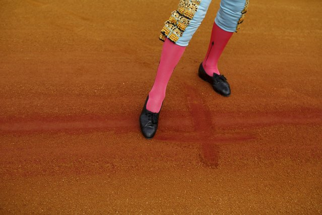 Spanish matador Juan Jose Padilla makes a sign of the cross with his foot on the arena ground before the start of a bullfight at The Maestranza bullring in the Andalusian capital of Seville, southern Spain April 25, 2015. (Photo by Marcelo del Pozo/Reuters)