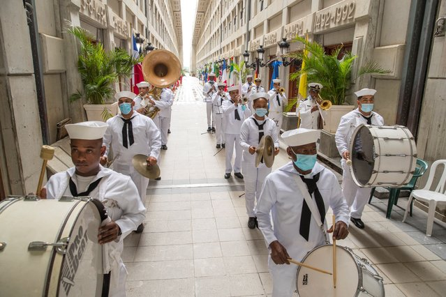 Members of the Armada music band perform during a tribute at the Mausoleum of the Columbus Lighthouse, where the remains of Cristobal Colon (Christopher Columbus) supposedly rest, on the day of the 529th anniversary of the arrival of the admiral to America, in Santo Domingo, Dominican Republic, 12 October 2021. (Photo by Orlando Barria/EPA/EFE)