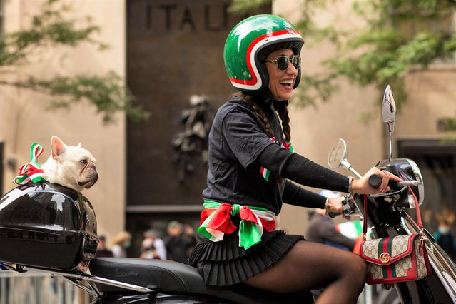 A woman rides a Vespa during the Annual Columbus day parade in New York on October 11, 2021. (Photo by Kena Betancur/AFP Photo)