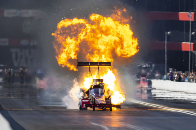 NHRA top fuel driver Spencer Massey explodes the engine of his dragster on fire during the Thunder Valley Nationals at Bristol Dragway on October 17, 2021. Massey was unhurt in the incident. (Photo by Mark J. Rebilas/USA TODAY Sports)