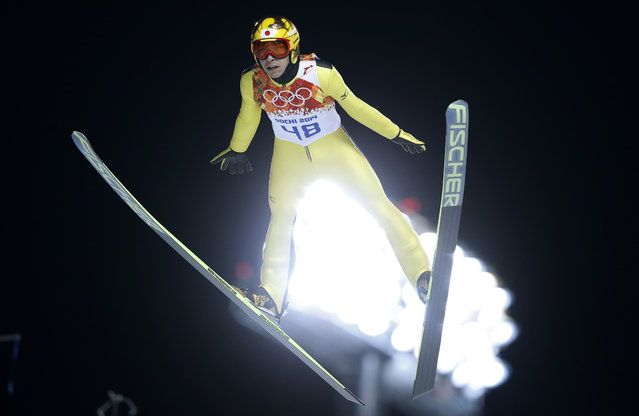 Japan's Noriaki Kasai makes his trial jump during the men's normal hill ski jumping final at the 2014 Winter Olympics, Sunday, February 9, 2014, in Krasnaya Polyana, Russia. (Photo by Matthias Schrader/AP Photo)