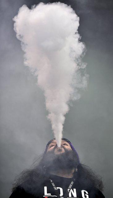 Joe Rodriguez exhales a plume of vapor at the Vape Summit 3 in Las Vegas, Nevada May 2, 2015. (Photo by David Becker/Reuters)