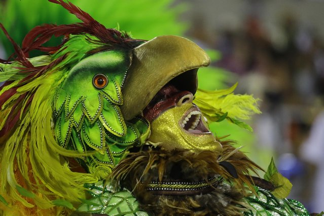 Performers from the Salgueiro samba school parade during carnival celebrations at the Sambadrome in Rio de Janeiro, Brazil, Monday, March 3, 2014. (Photo by Nelson Antoine/AP Photo)