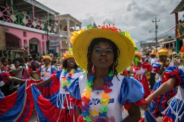 Haitians dressed in costumes dance during the Haitian National Carnival in Jacmel, Haiti, 19 February 2017. Locals and foreigners gathered to enjoy the colorful carnival in which parades are full of art, music and dance. (Photo by Bahare Khodabande/EPA)