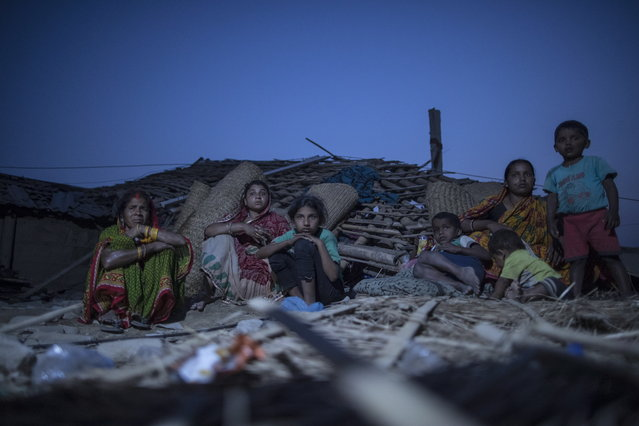 Nepalese storm victim families rest among the rubbles at Bhaluhi village in Bara District, Nepal, 01 April 2019. At least 27 people have died and hundreds were injured as a massive storm hit several places in the southern district of Bara and Parsa, according to media reports. (Photo by Narendra Shrestha/EPA/EFE)