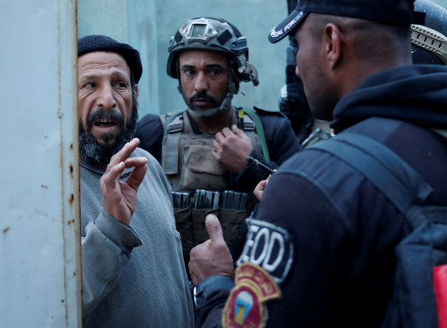 A man speaks to Iraqi Special Forces soldiers as they search his house for Islamic State fighters in Mosul, Iraq February 27, 2017. (Photo by Goran Tomasevic/Reuters)